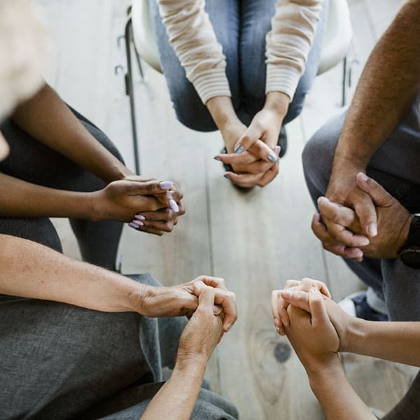 Diverse people in a religious group session, prayer